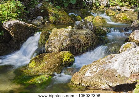 Mountain River Flowing Among Mossy Stones.
