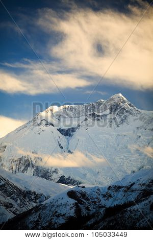 Mountain inspirational landscape in Himalayas Annapurna range Nepal. Mountain ridge with ice and snow over clear blue sunny sky. poster