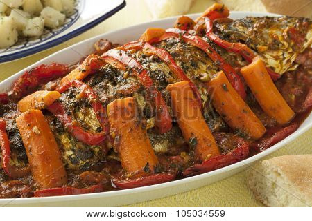 Moroccan fish tagine with chermoula in a dish
