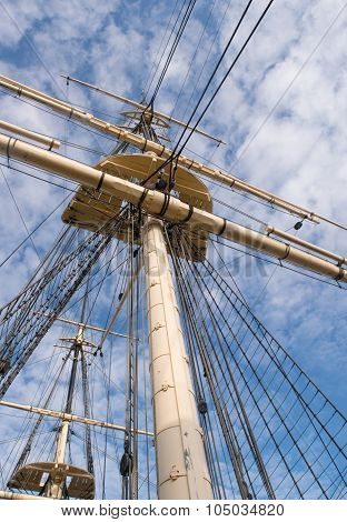 Wooden Sailship Rigging Against Blue Sky With Clouds