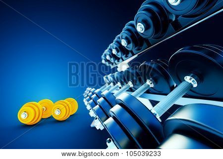 Row Of Metal Dumbells With Orange Dumbbells On Blue Background