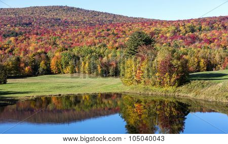 Stunning fall foliage and lake in Vermont, USA