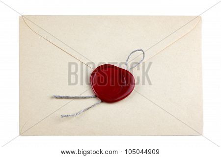 old mail envelope with red wax seal stamps isolated on white