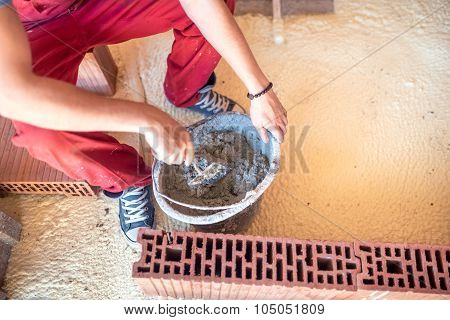Industrial Construction Worker, Preparing Mortar For Building Brick Walls. Worker Mixing Mortar With