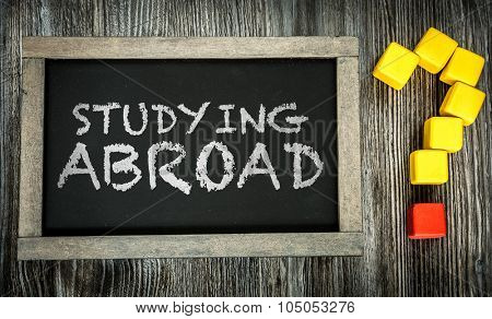 Studying Abroad? written on chalkboard