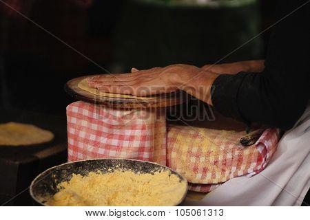 Woman making a tortilla