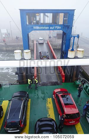 WYK GERMANY - OCTOBER 3. The ferry dock in the port of Wyk of Foehr (Germany Schleswig Holstein North Frisia) photographed on the foggy morning of October 3 2015. poster