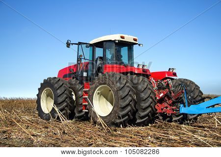 Powerful Tractor Working In The Field