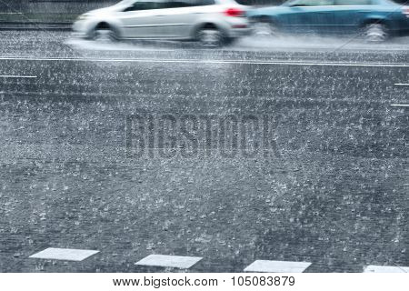 Rainy City With Driving Cars