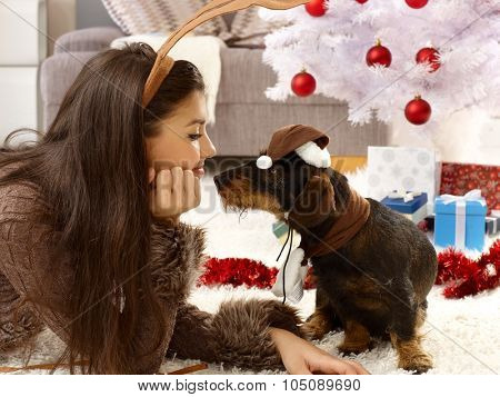 Lovely christmas photo of woman and dog in harmony.