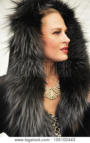 Beautiful Young Woman Wearing Fur Coat With A Hood