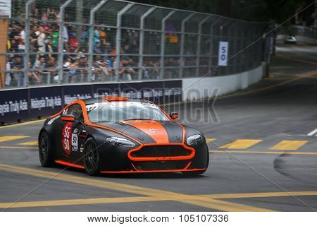 KUALA LUMPUR, MALAYSIA - AUGUST 08, 2015: Gerald Yap drives a Vantage N24 GT4 car takes turn 2 of the city streets in the KL City GT CUP Race of the 2015 Kuala Lumpur City Grand Prix.