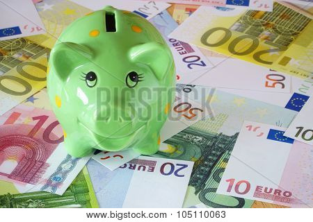 Piggy Bank On Euro Banknotes