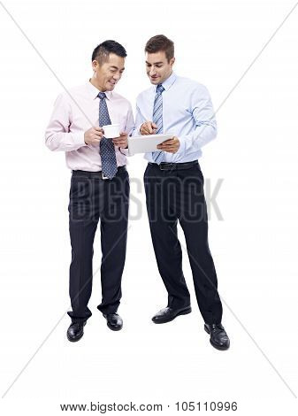 Asian And Caucasian Businessmen Having A  Discussion