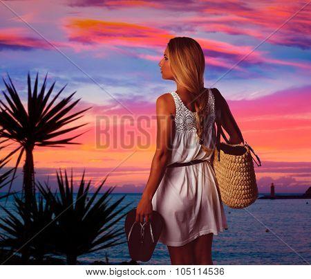 Blond tourist girl sunset in Andratx Mallorca port sunset photomount