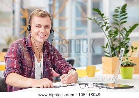 Cheerful customer surface representative is working in office