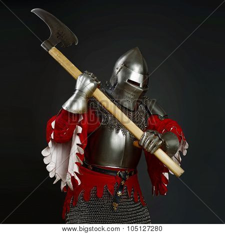 Medieval knight with an axe  on grey background
