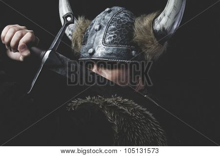 Furious, Viking warrior with iron sword and helmet with horns poster