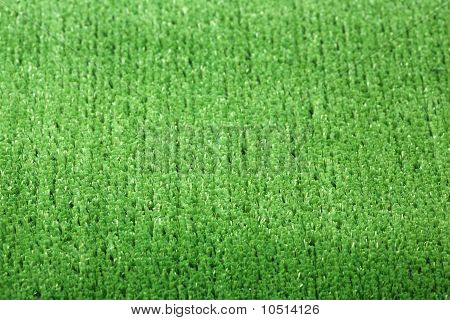 Green background - an artificial lawn with a short grass poster