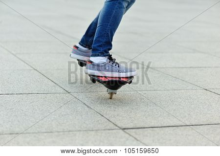 young woman legs riding on ripstick