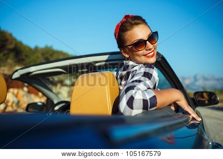 Beautiful Pin Up Woman Sitting In Cabriolet, Enjoying Trip On Luxury Modern Car With Open Roof