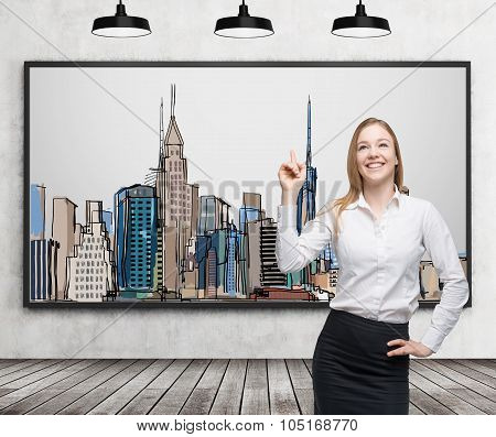 A Beautiful Lady Is Pointing Out The Picture Of New York City On The Wall. Wooden Floor, Concrete Wa