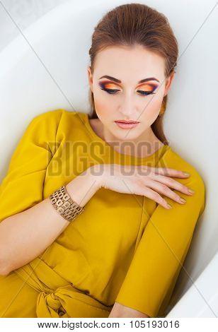 Beautiful Girl With Make Up Wearing Long Yellow Dress
