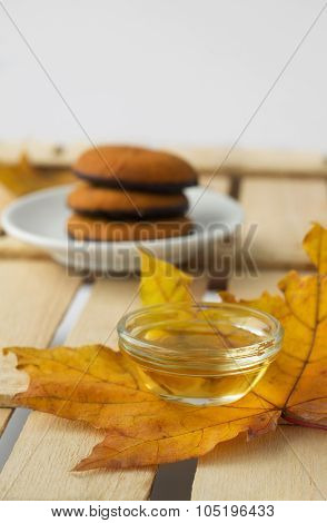 maple syrup honey and yellow maple leaf and biscuits