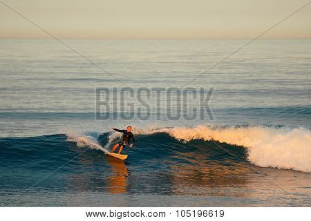 San Diego, CA - MAY 18: Surfer with tide in the morning on May 18, 2014 in San Diego. It is the eighth-largest city in US and second-largest in CA
