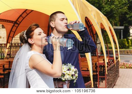 The Bride And Groom Quench Thirst