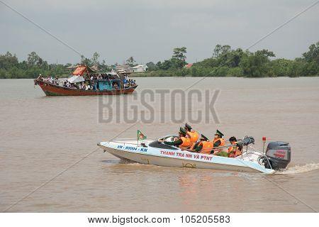 Police Patrol The Harbour In Mekong Delta, Vietnam