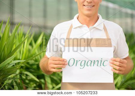 Pleasant florist holding notice.