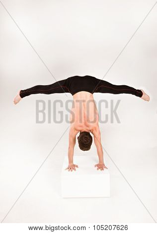 Man Stretch Gymnastic Balance Posture Isolated Studio On White Background.