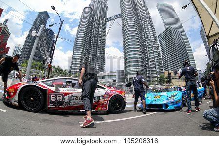 KUALA LUMPUR, MALAYSIA - AUGUST 09, 2015: The Lamborghini car of drivers H. Akagi and K. Hiramine make a pit stop in the Lamborghini Blancpain Super Trofeo Race of the 2015 KL City Grand Prix.