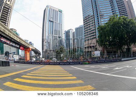 KUALA LUMPUR, MALAYSIA - AUG 09, 2015: An unidentified single-seater race car races in the city street circuit in the Formula Masters China Series Race of the 2015 Kuala Lumpur City Grand Prix.