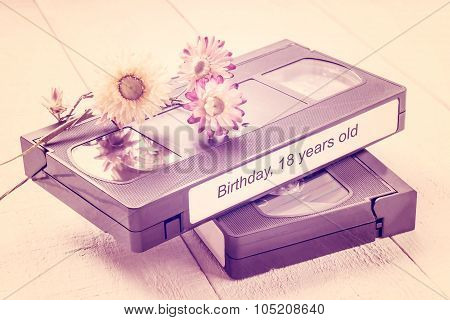 Old Videotapes And Dry Flowers. Tinted Photos