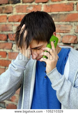 Sad Young Man With Cellphone