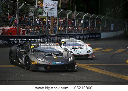 KUALA LUMPUR, MALAYSIA - AUGUST 09, 2015: Lamborghini Super Trofeo LP620 cars race in the city street circuit in the Lamborghini Blancpain Super Trofeo Race at the 2015 Kuala Lumpur City Grand Prix.