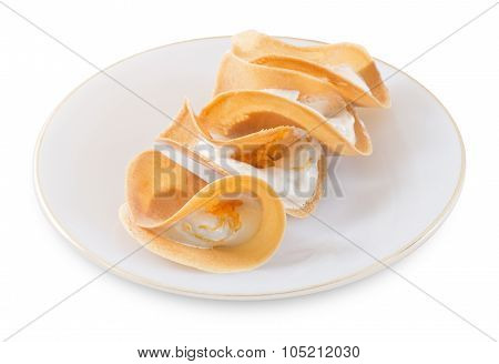 Thai Crispy Crepes Filled With Cream And Fios De Ovos