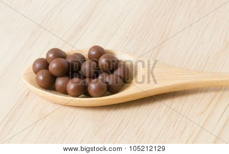 Herbal Cough Lozenges On A Brown Wooden Spoon