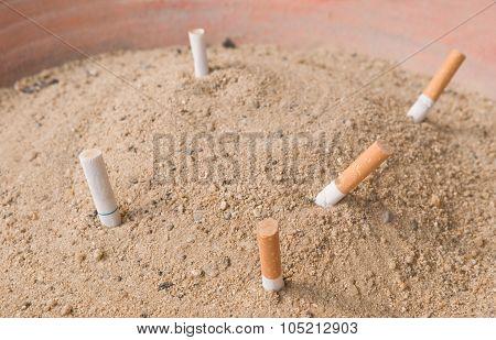 Cigarettes Butts In An Ashtray Big Bin
