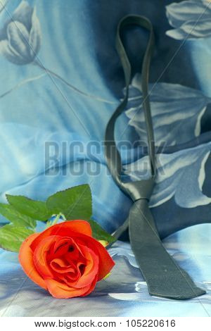 Black Nectie With Red Roses On A Blue Background