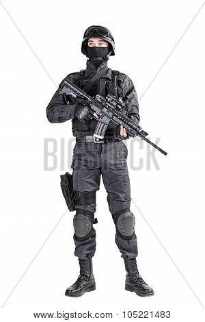 Spec ops police officer SWAT in black uniform studio shot poster