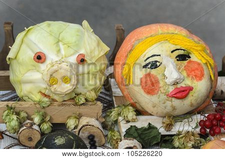 Pumpkin As A Person And Cabbage In The Form Of The Head Of The Pig
