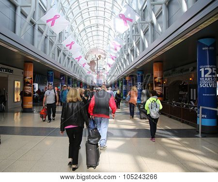 Grand Concourse decorated with Breast Cancer awareness campaign flags at O'Hare Airport