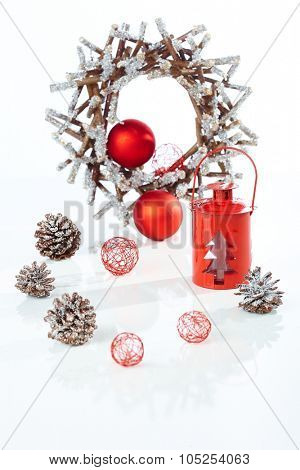 Christmas decoration with night-light wreath and ornaments over white background.