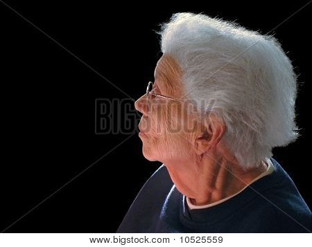 White-haired woman on black background