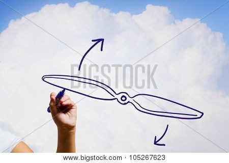 Person drawing plane propeller on sky background poster