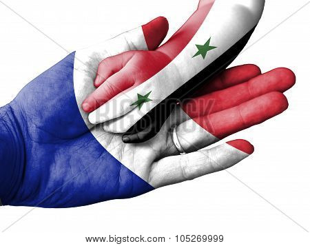 Adult Man Holding A Baby Hand With France And Syria Flags Overlaid. Isolated On White