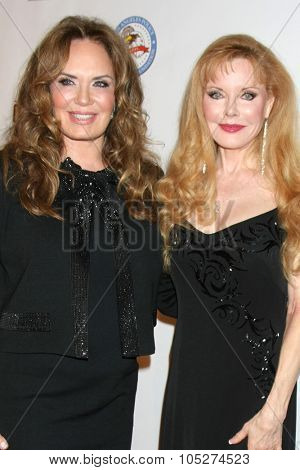 LOS ANGELES - OCT 17:  Catherine Bach, Rebecca Holden at the  LAPD Eagle & Badge Foundation Gala at the Century Plaza Hotel on October 17, 2015 in Century City, CA